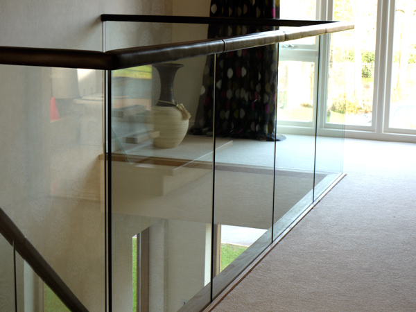 glass gallery with leather handrail
